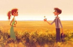 hombre ofreciendo flor a una chica