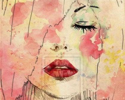 Cara de mujer con los ojos cerrados y los labios rojos mostrando sensibilidad