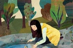 Mujer mirando su reflejo en el agua