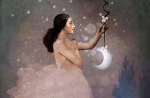 Mujer sujetando la luna