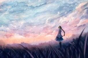 Niña mirando el horizonte en silencio