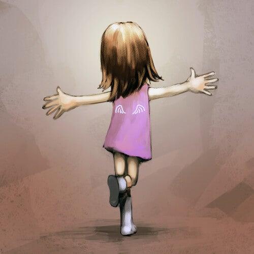 Niña con un vestido rosa feliz y bailando