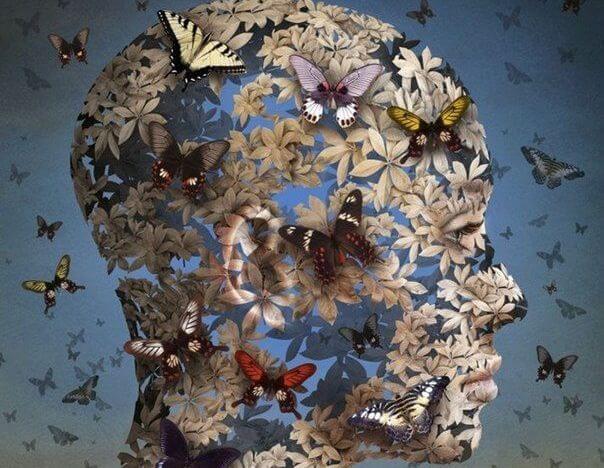 cabeza femenina perfilada en mariposas