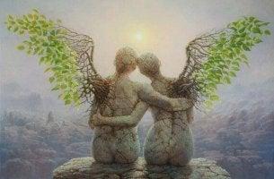 Dos ángeles sentados y agarrados por la espalda