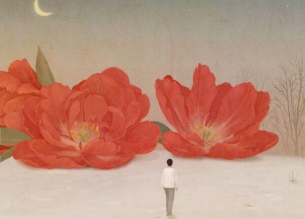 hombre avanzando hacia dos grandes flores rojas