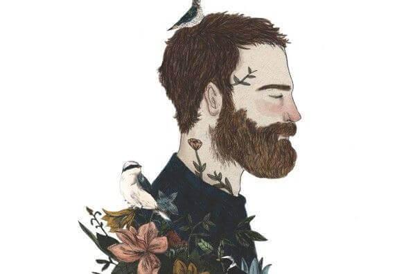 Hombre con barba y pájaro en la cabeza