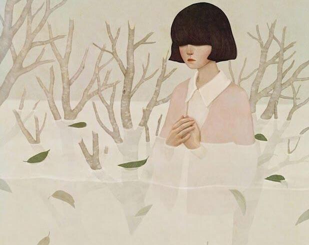 joven con melena en un río blanco