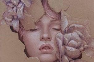 Mujer con los ojos cerrados y con flores alrededor