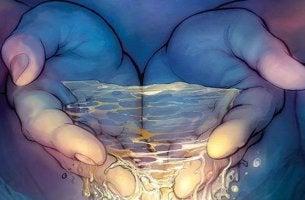 manos conteniendo agua reluciente