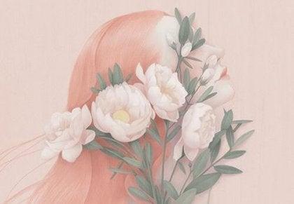 mujer envuelta en flores rosadas