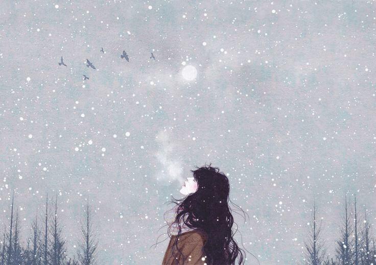 mujer suspirando entre la nieve