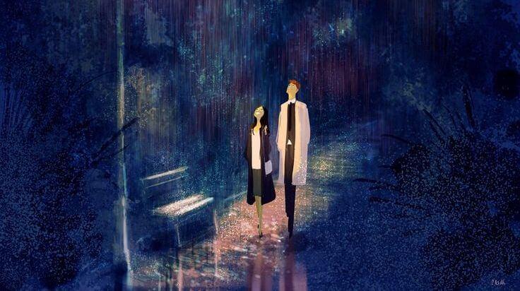 pareja paseando en una noche de lluvia disfrutando de la vida