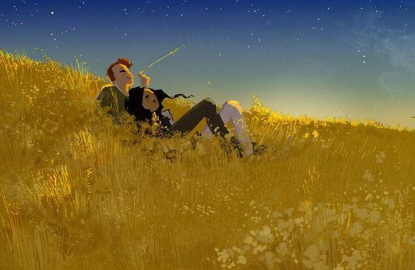 Pareja tumbada sobre un campo de cereal