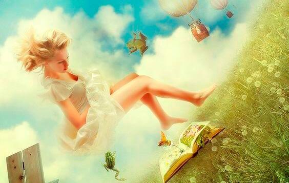 chica con vestido blanco sobre un libro
