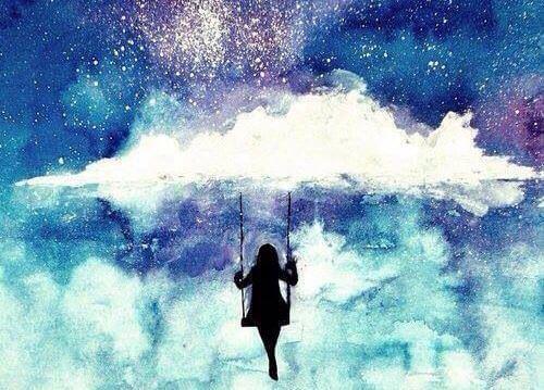 chica en un columpio colgado de las nubes