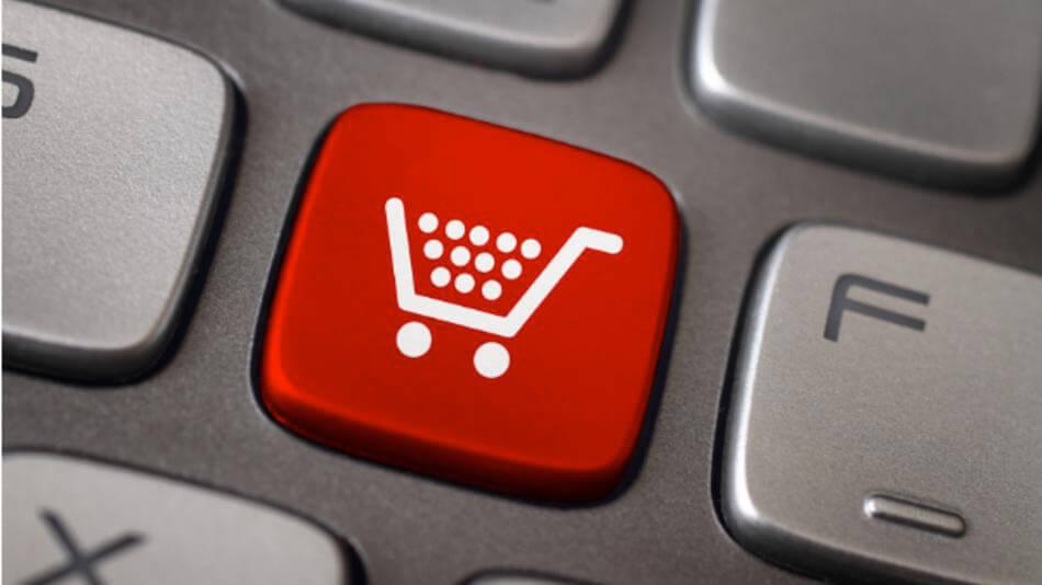 Botón rojo con un carrito para comprar online