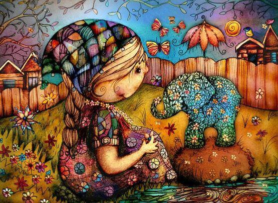 Niña con un elefante de flores