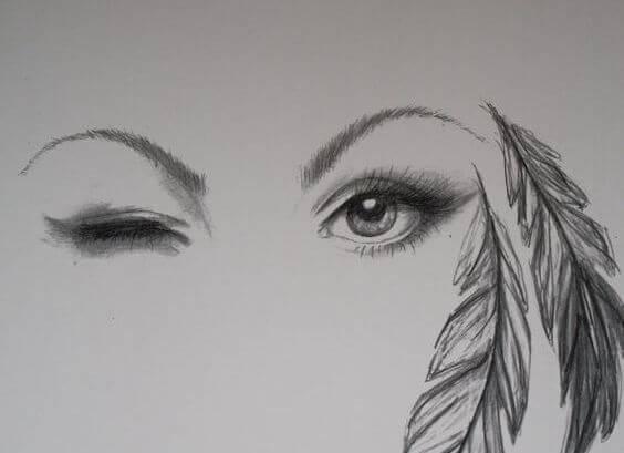 rostro de mujer con pluma a un lado