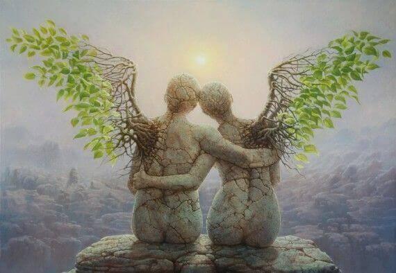 Dos ángeles agarrados y sentados