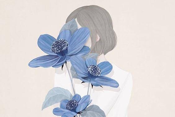 joven con flores azules representando bondad