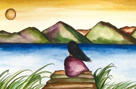 mujer ante un lago