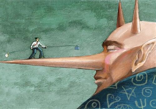 Hombre haciendo equilibrismo por la nariz de otro