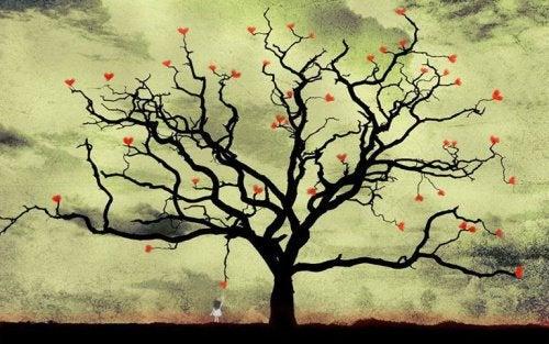 Niña cogiendo corazones de un árbol