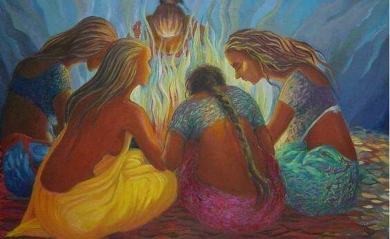 madres e hijas rodeando una hoguera