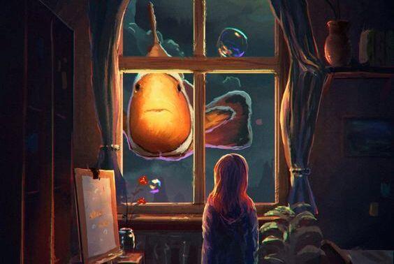 niña ante una ventana mirando un pez y aplicando el método Montessori