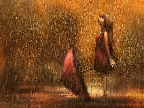 Chica mirando la lluvia