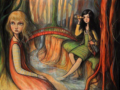 Chicas sentadas al lado del río