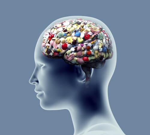 Perfil de una cabeza llena de pastillas