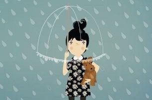 Chica con un paraguas mostrando orgullo