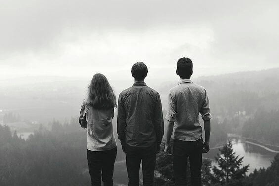 three people on mountain