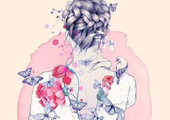 Mujer con flores sintiendo caricias