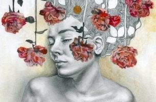 Mujer con rosas cerca de su cara