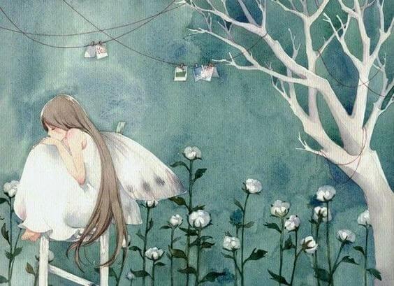 mujer sentada en flores