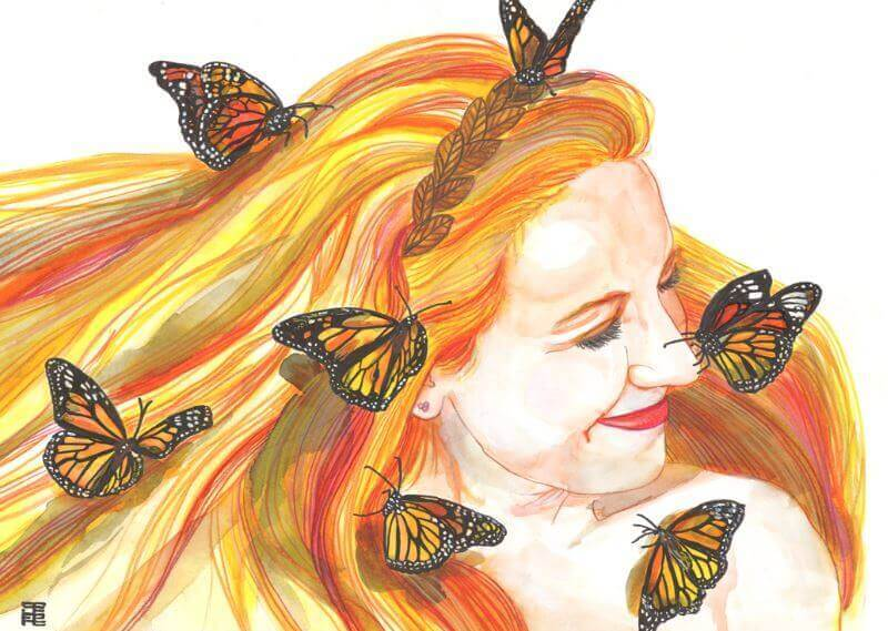 Mujer sonría rodeada de mariposas