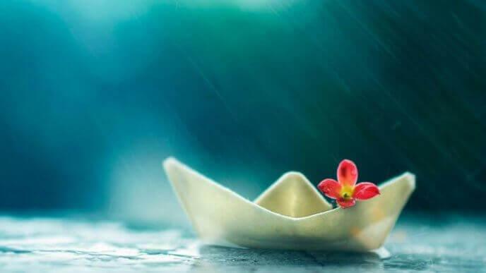 Bote de papel simbolizando meditación universal