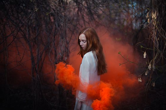 red smoke around girl