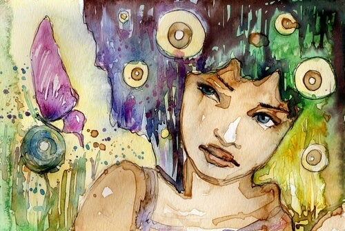 Mujer pensando entre mariposas
