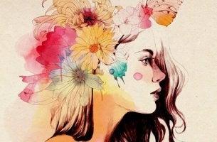 mujer con flores que ha superado situaciones difíciles