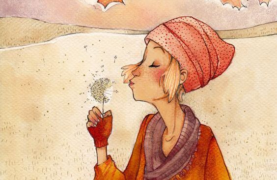 woman blowing dandelion