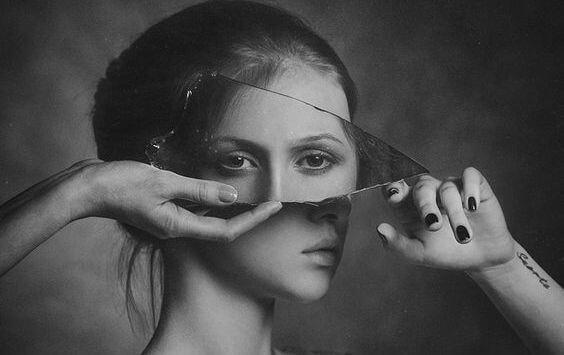 reflection of eyes in broken mirror