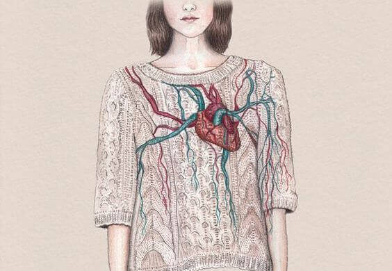 Woman with a heart on her chest symbolizing things that make us feel alive.