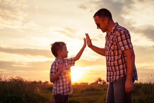 man high-fiving son