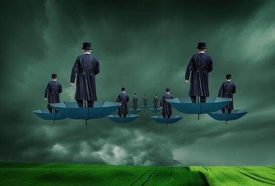 Hombres sobre paraguas representando la mente pobre