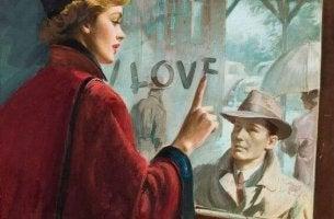 Mujer escribiendo amor en la ventana del tren