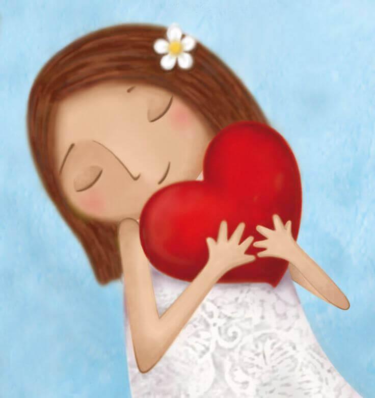 Niña abrazando a un corazón