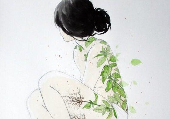 Mujer con hojas en su espalda